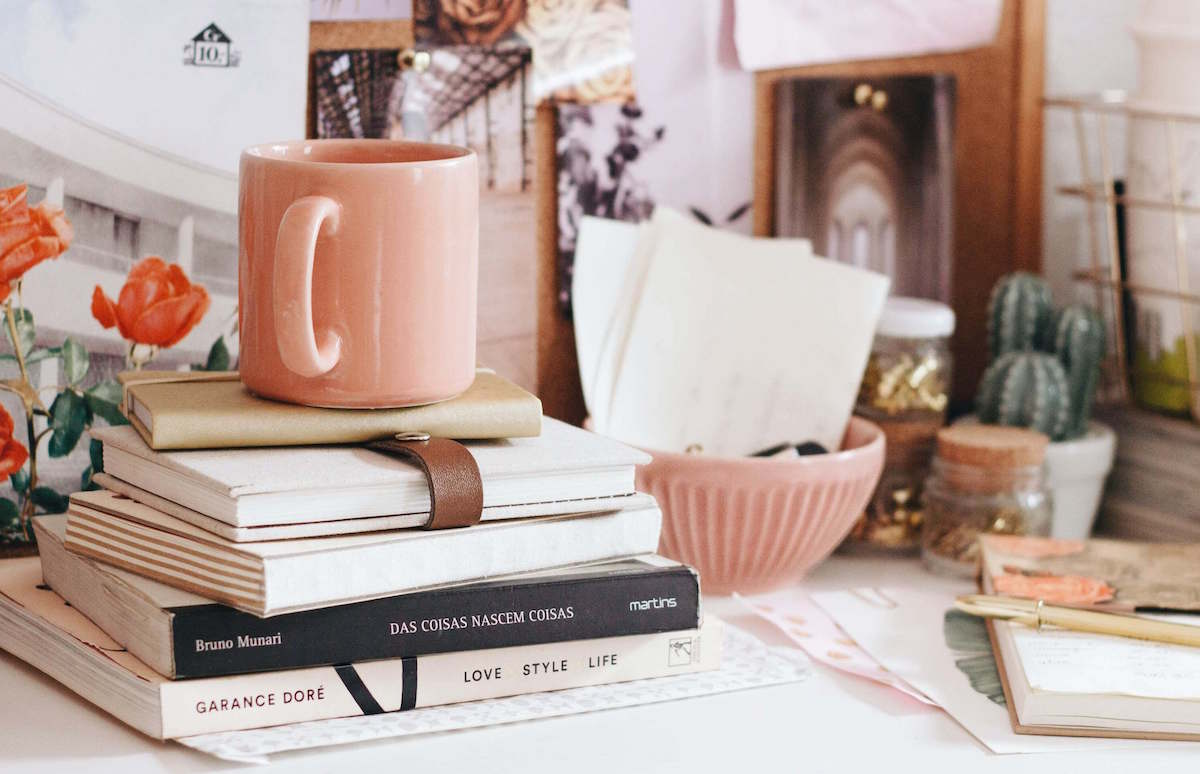 start writing about books and coffee cups on beautifully decorated vintage table