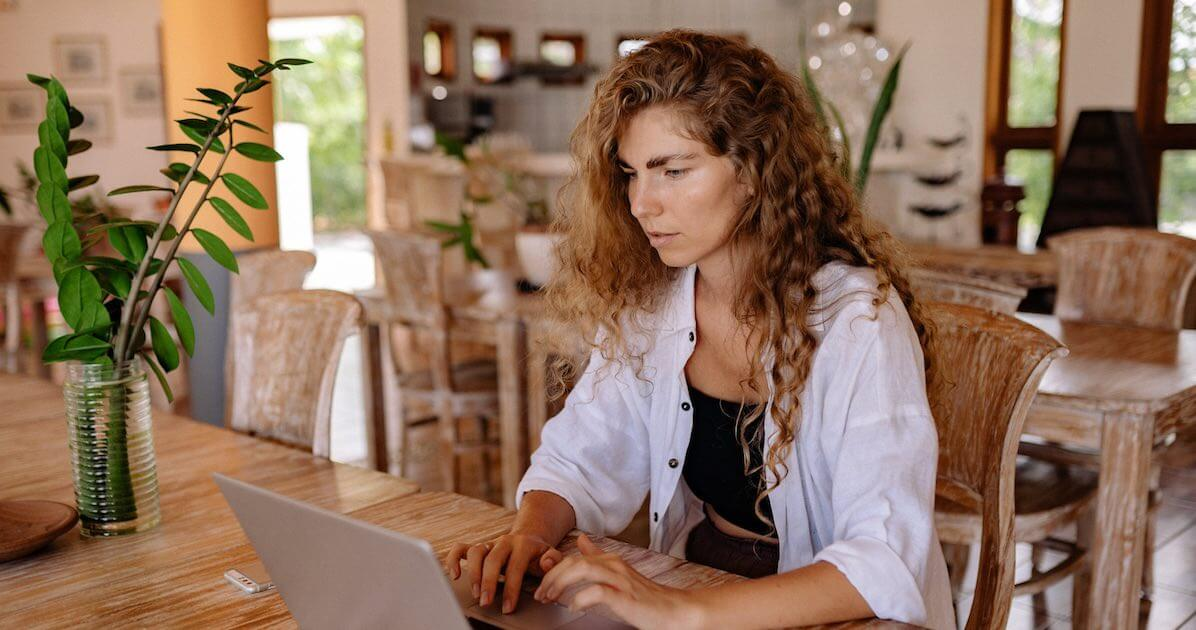 beautiful woman with curly hair fighting with consistent writing enemies